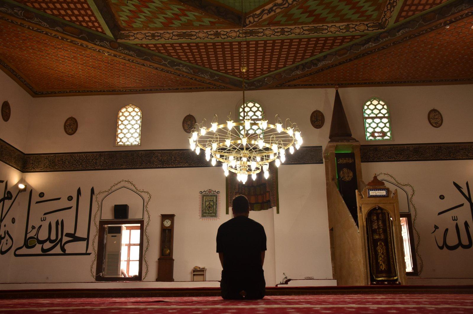 A person performs prayer in Rüstem Pasha Mosque, Bilecik, northwestern Turkey, June 27, 2021. (AA Photo)