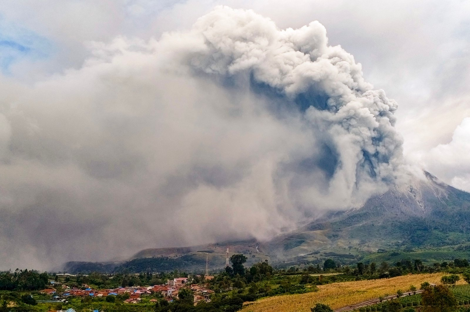 Mount Sinabung erupts, spewing a massive column of smoke and ash as seen from Karo, North Sumatra, Indonesia, July 28, 2021. (AFP Photo)