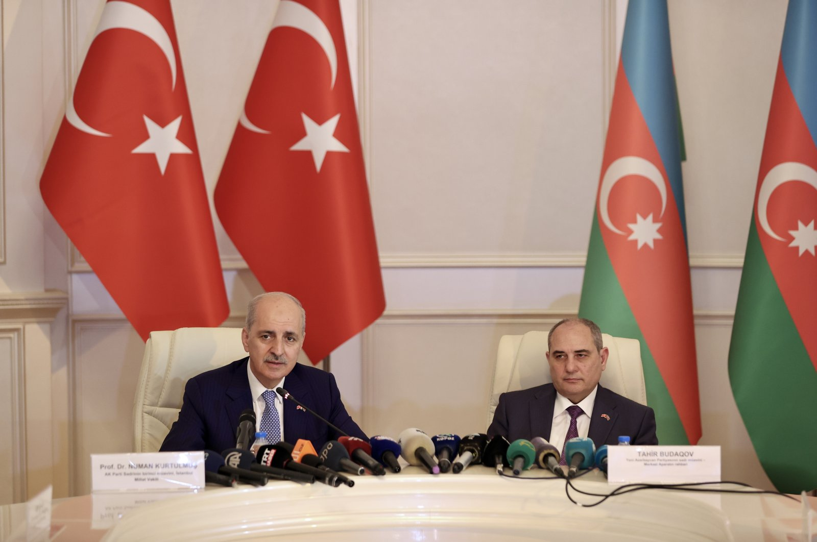 Turkey's ruling Justice and Development Party (AK Party) Deputy Chair Numan Kurtulmuş (R) and New Azerbaijan Party (YAP) Deputy Chairprson Tahir Budagov in Baku, Azerbaijan, July 28, 2021. (AA Photo)