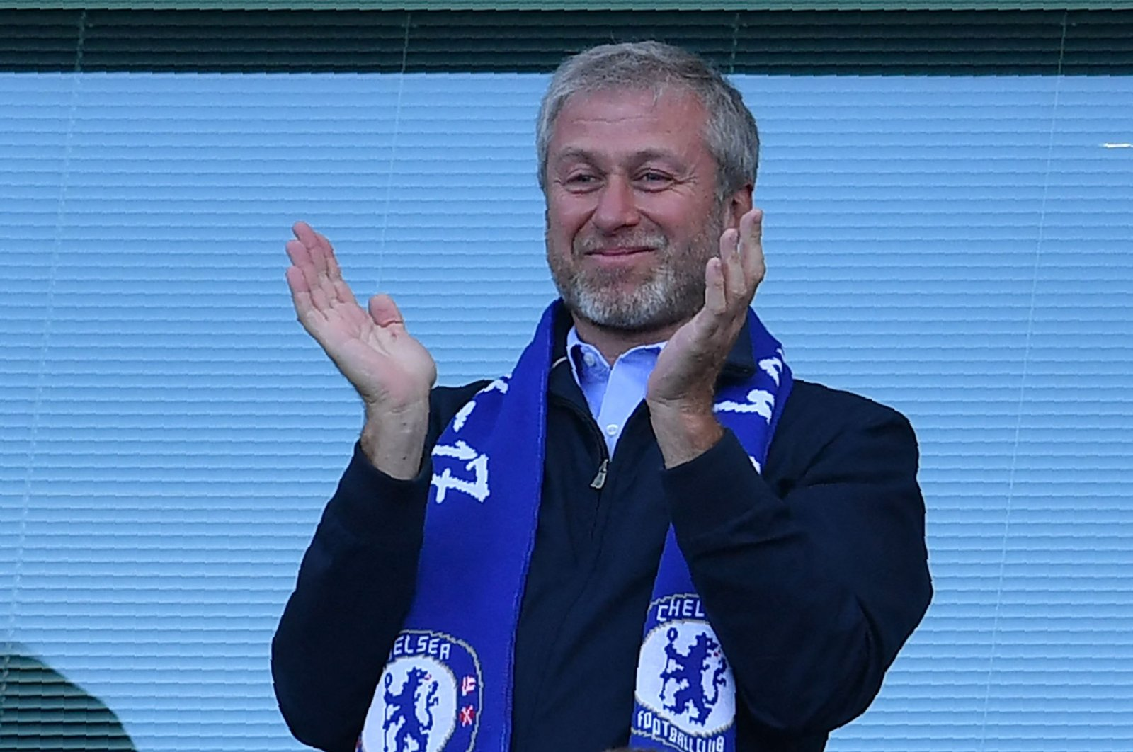Chelsea's Russian owner Roman Abramovich applauds, as players celebrate their league title win at the end of the Premier League football match between Chelsea and Sunderland at Stamford Bridge in London, May 21, 2017. (AFP Photo)
