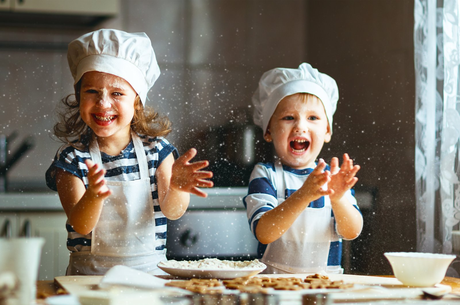Kids cooking in the kitchen. (Shutterstock Photo)