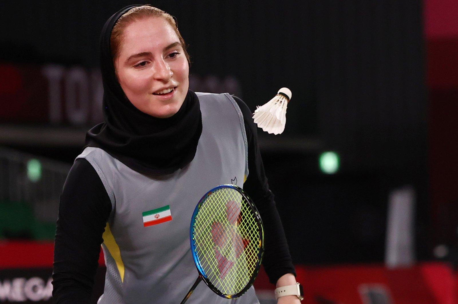 Iran's Soraya Aghaeihajiagha in action against China's He Bingjiao in Tokyo 2020 Olympics badminton women's singles match, Tokyo, Japan, July 28, 2021.
