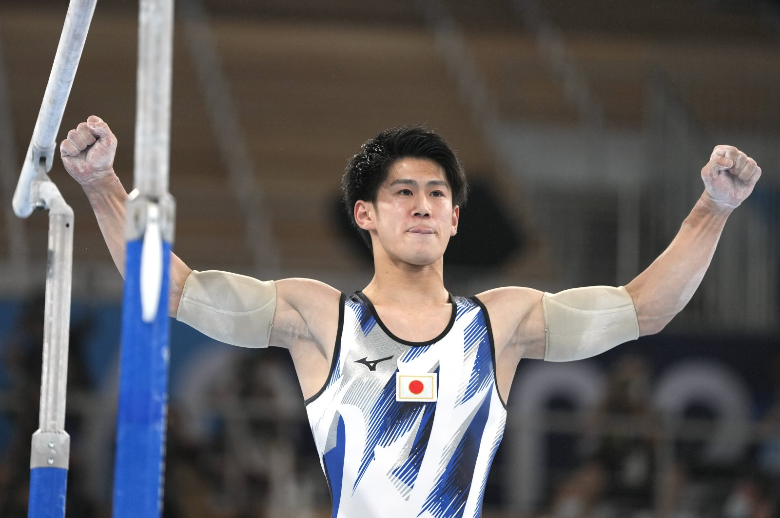 Japan's Daiki Hashimoto finishes on the parallel bars during the artistic gymnastics men's all-around final at the 2020 Summer Olympics, Tokyo, Japan, July 28, 2021. (AP Photo)