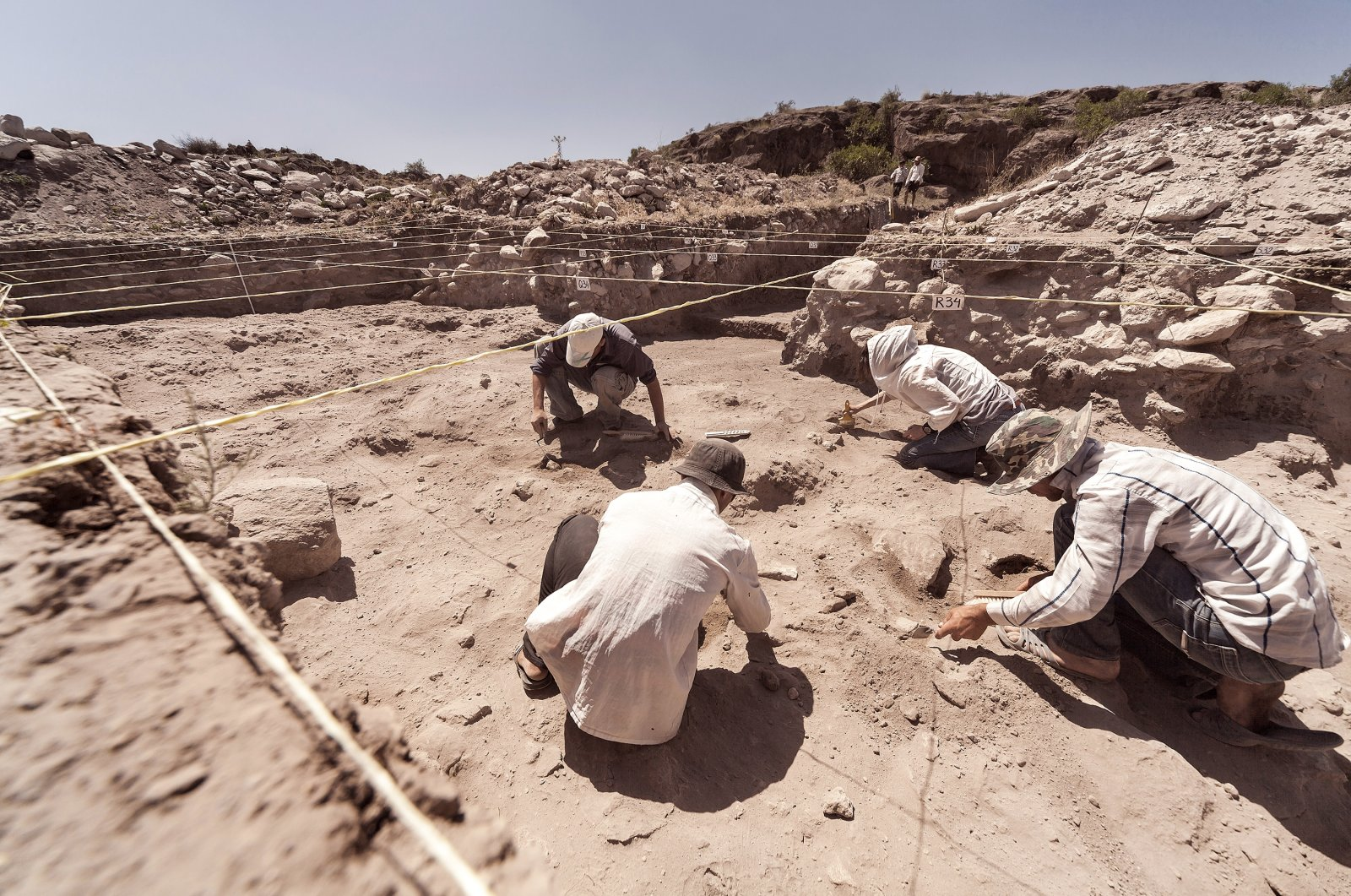 Archaeologists working on a dig. (Shutterstock Photo)