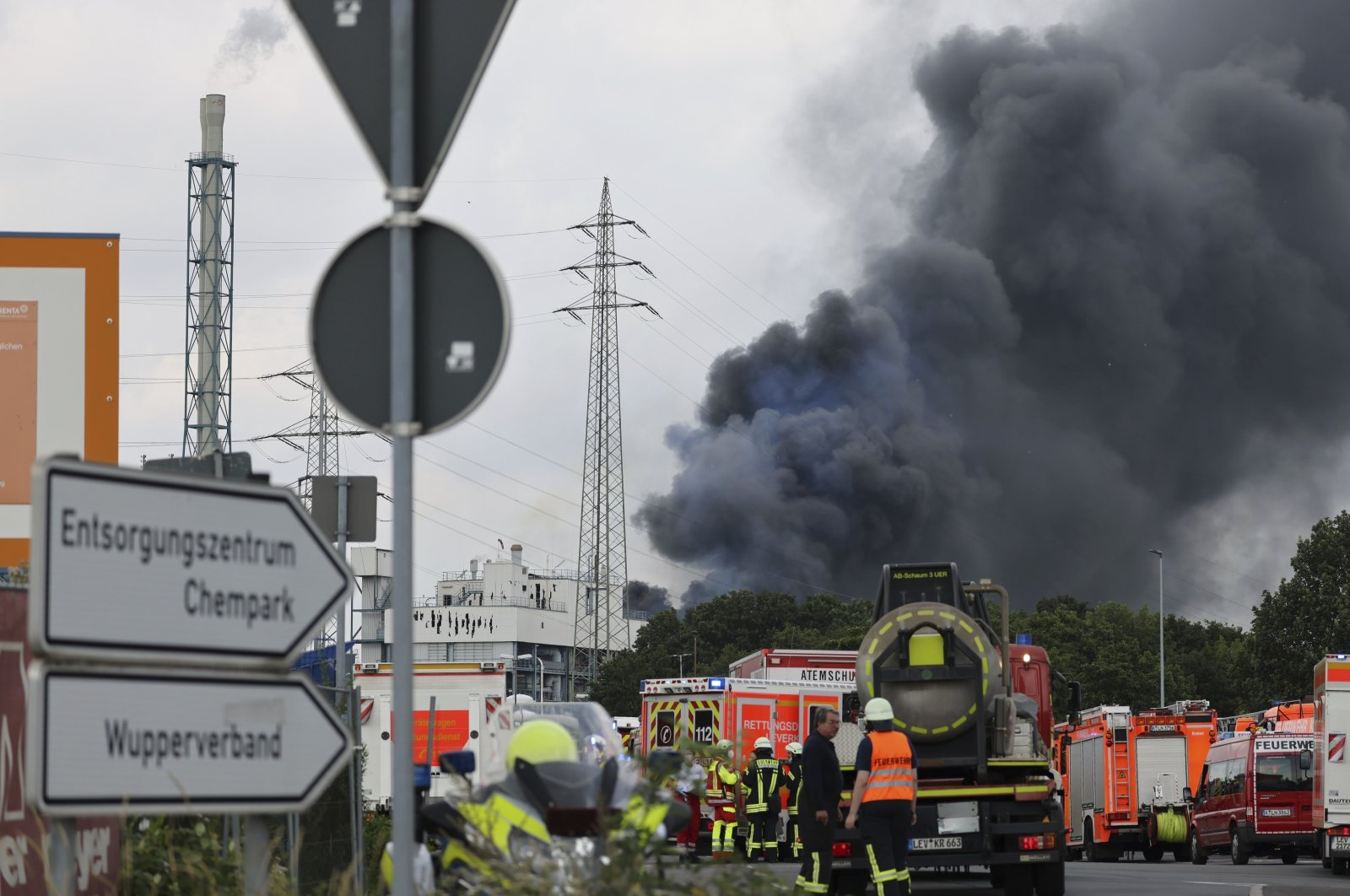 A dark cloud of smoke rises above the Chempark in Leverkusen, Germany, Tuesday, July 27, 2021. After an explosion, fire brigade, rescue forces and police are currently in a large-scale operation, the police explained. (Oliver Berg/dpa via AP)