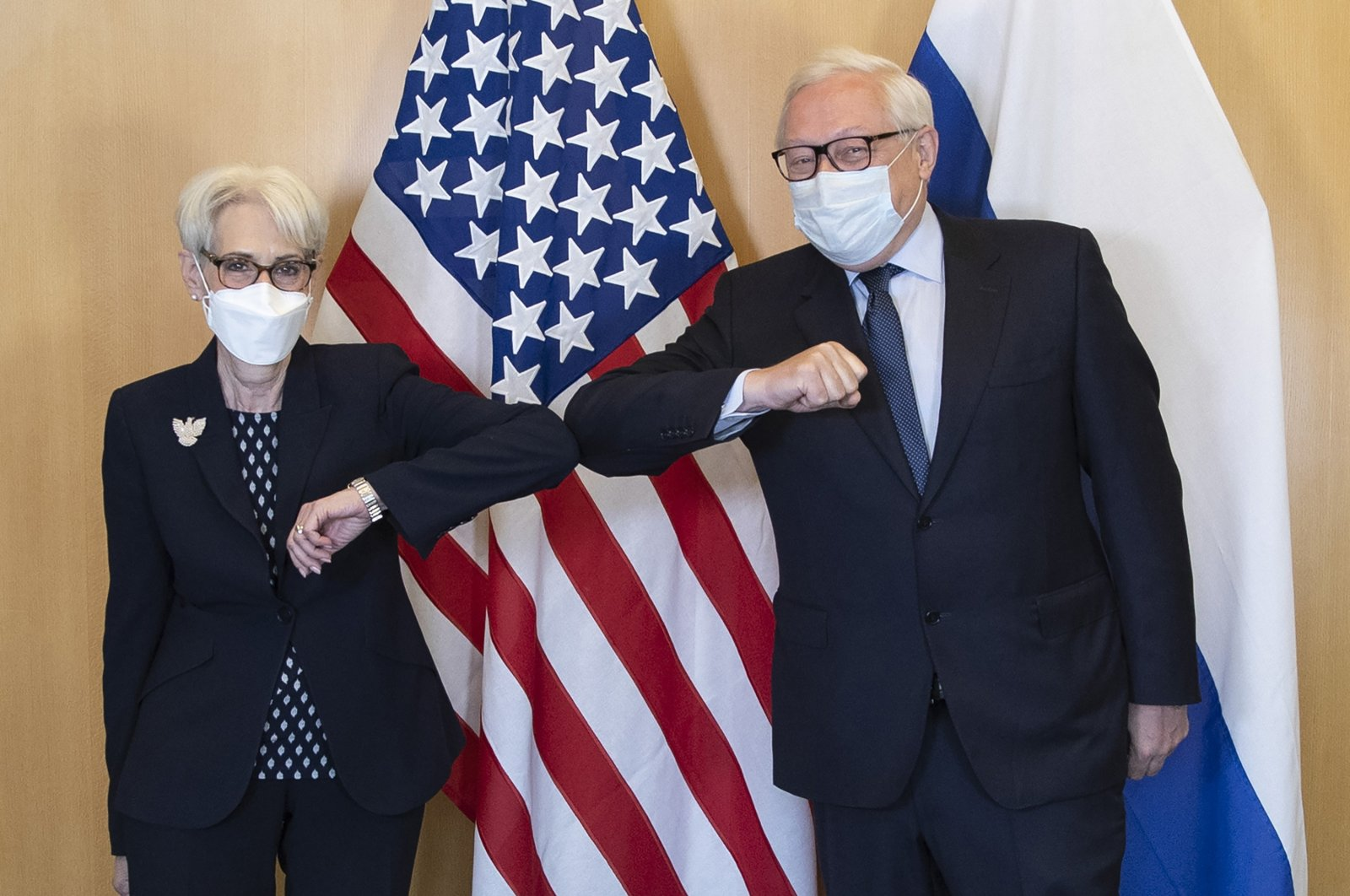 U.S. Deputy Secretary of State Wendy Sherman and Russian Deputy Foreign Minister Sergey Ryabkov greet each other at the start of their meeting in Geneva, Switzerland, July 28, 2021. (US Mission Geneva via AP)