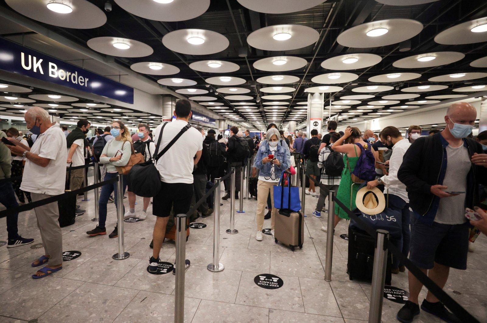 Arriving passengers queue at U.K. Border Control at Terminal 5 at Heathrow Airport in London, Britain June 29, 2021. (Reuters Photo)