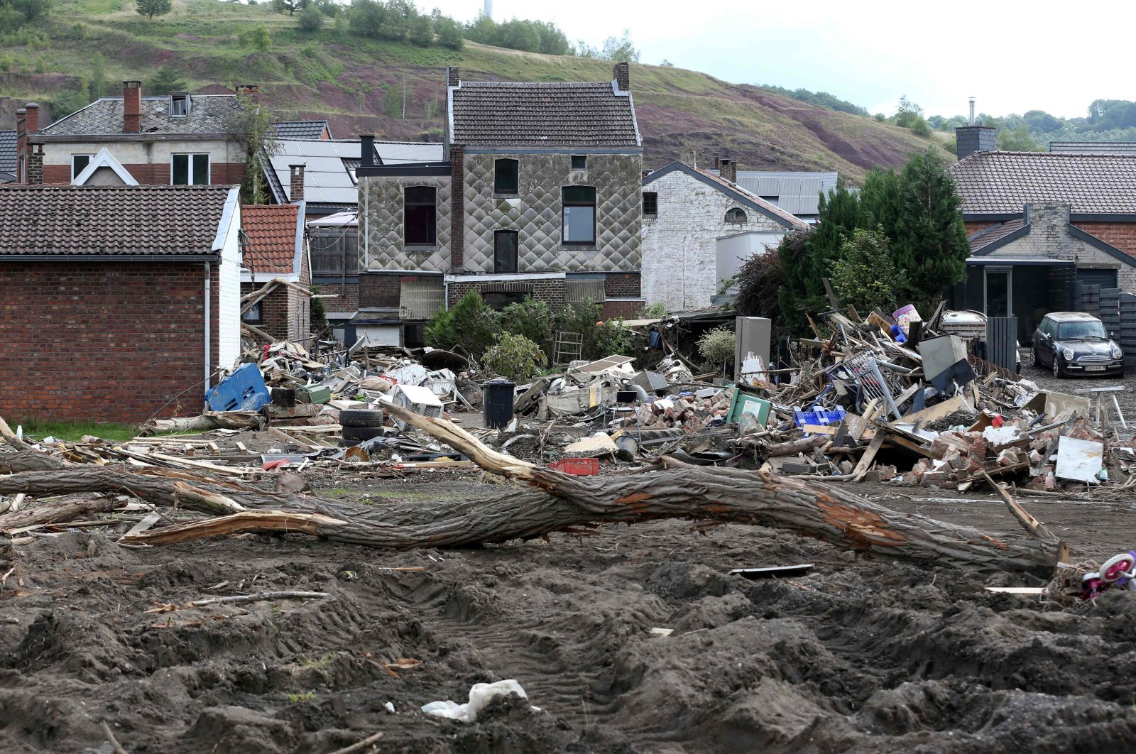 Piles of rubble collected from the flooded areas in the Belgian town of Trooz, a week after heavy rains and floods lashed western Europe, July 26, 2021. (AFP Photo)