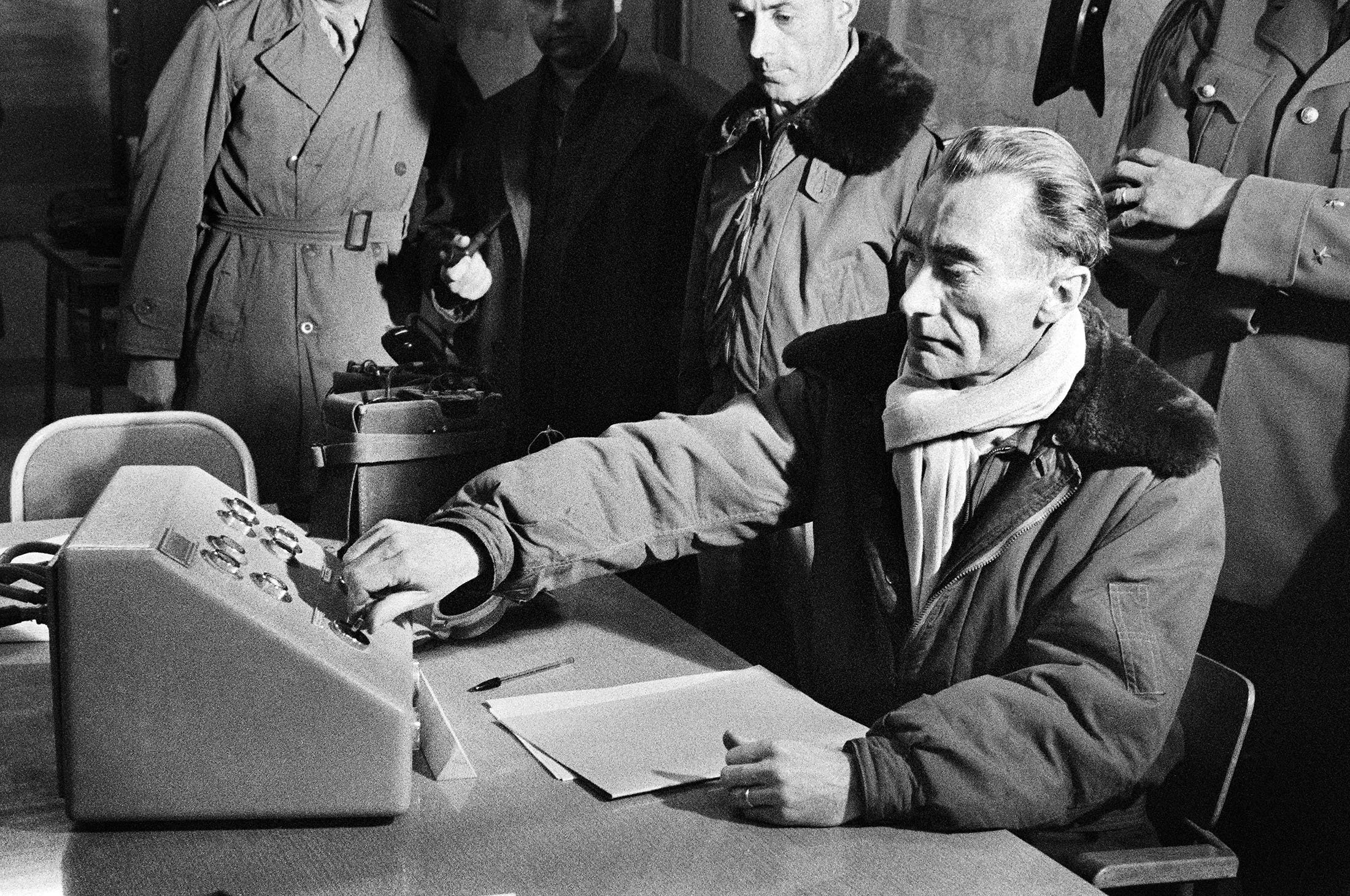 French Gen. Jean Thiry presses the button which triggers an explosion during the third French nuclear test at Reggane region in the Algerian Sahara as part of the operation called 'Gerboise rouge,' Dec. 27, 1960. (AFP Photo)