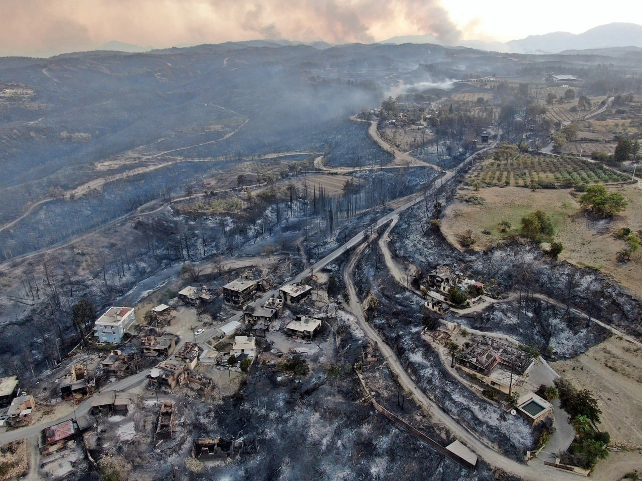 An aerial view of a residential area devastated by forest fire, in Manavgat district, in Antalya, southern Turkey, July 29, 2021. (İHA PHOTO)