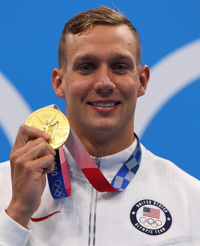 Tokyo 2020 Olympics Men's 100-meter Freestyle gold medallist U.S.'s Caeleb Dressel poses on the podium at Tokyo Aquatics Center, Tokyo, Japan, July 29, 2021. (Reuters Photo)