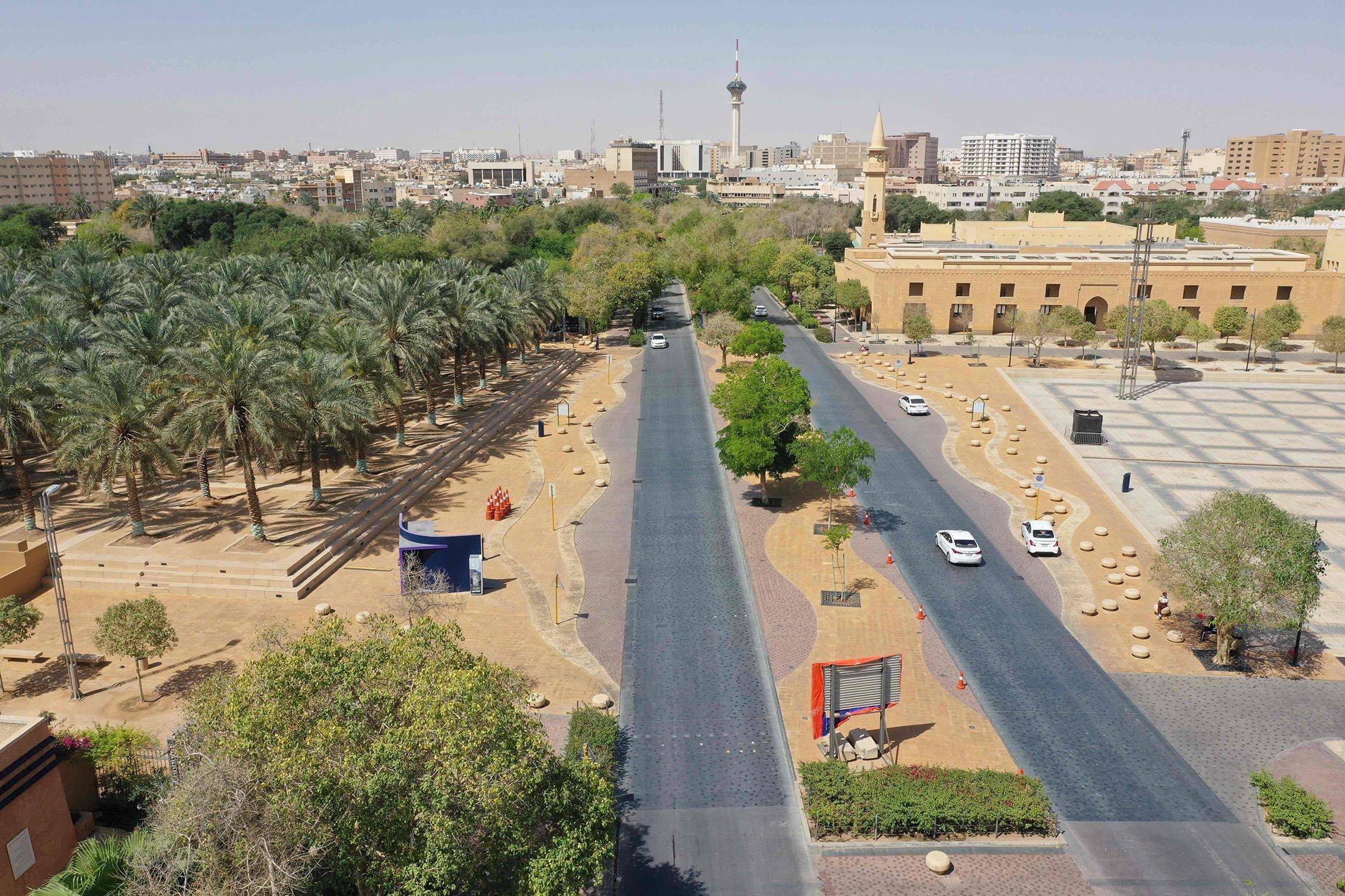 An aerial photo shows cars driving down a road next to a park areain the Saudi capital Riyadh, Saudi Arabia, March 29, 2021. (AFP Photo)
