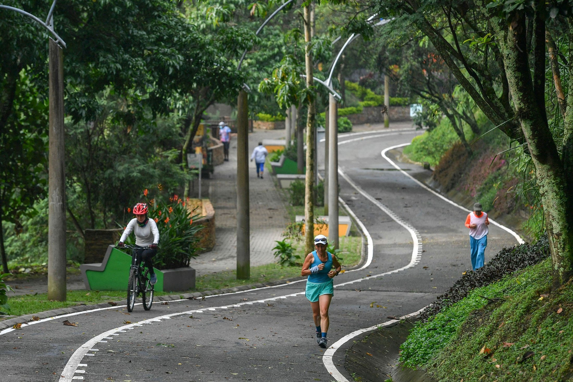 People excercize at the Volador hill in Medellin, Colombia, June 12, 2021. (AFP Photo)