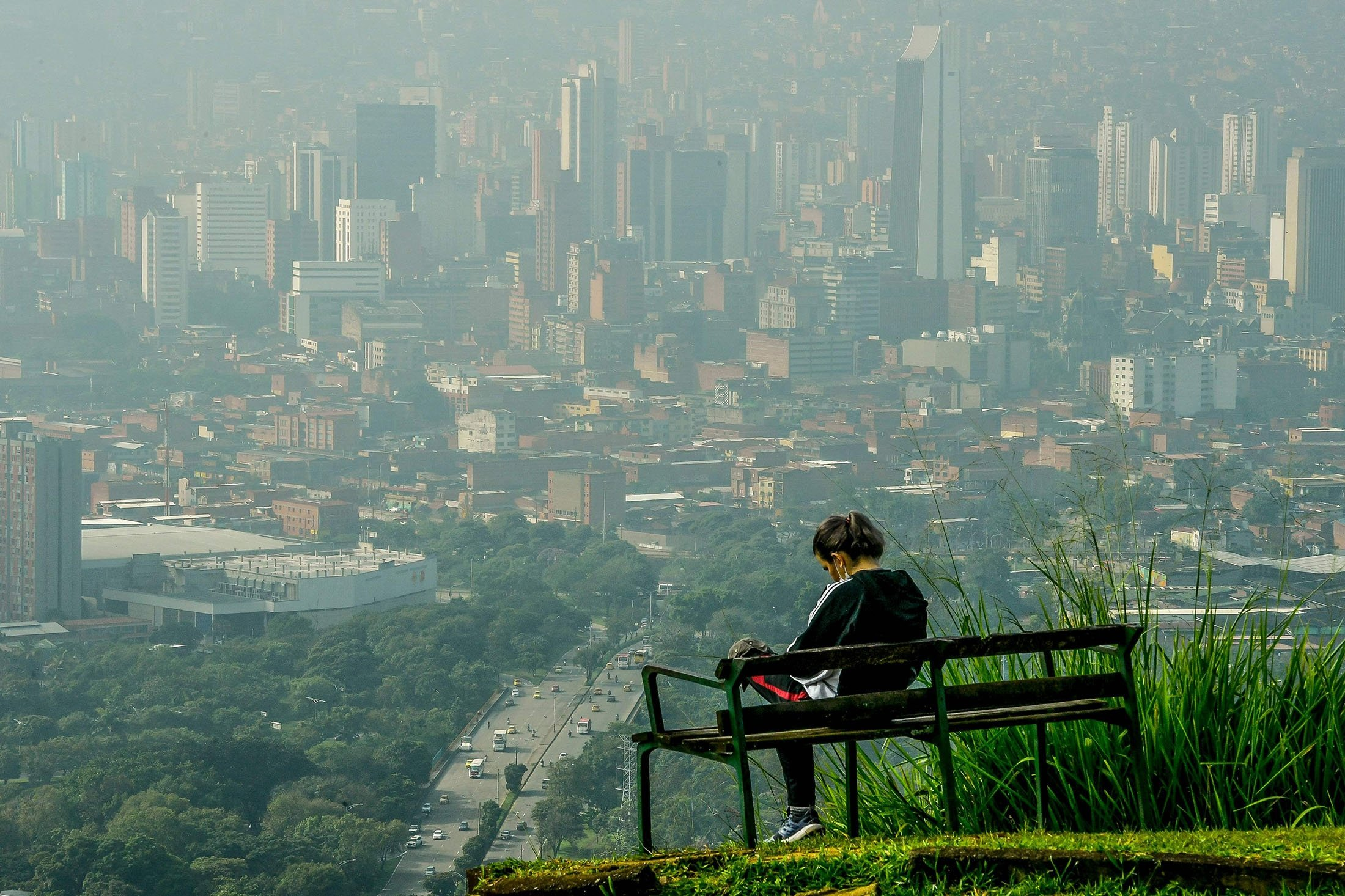 A woman wacthes the view from the Volador hill in Medellin, Colombia, June 12, 2021. (AFP Photo)