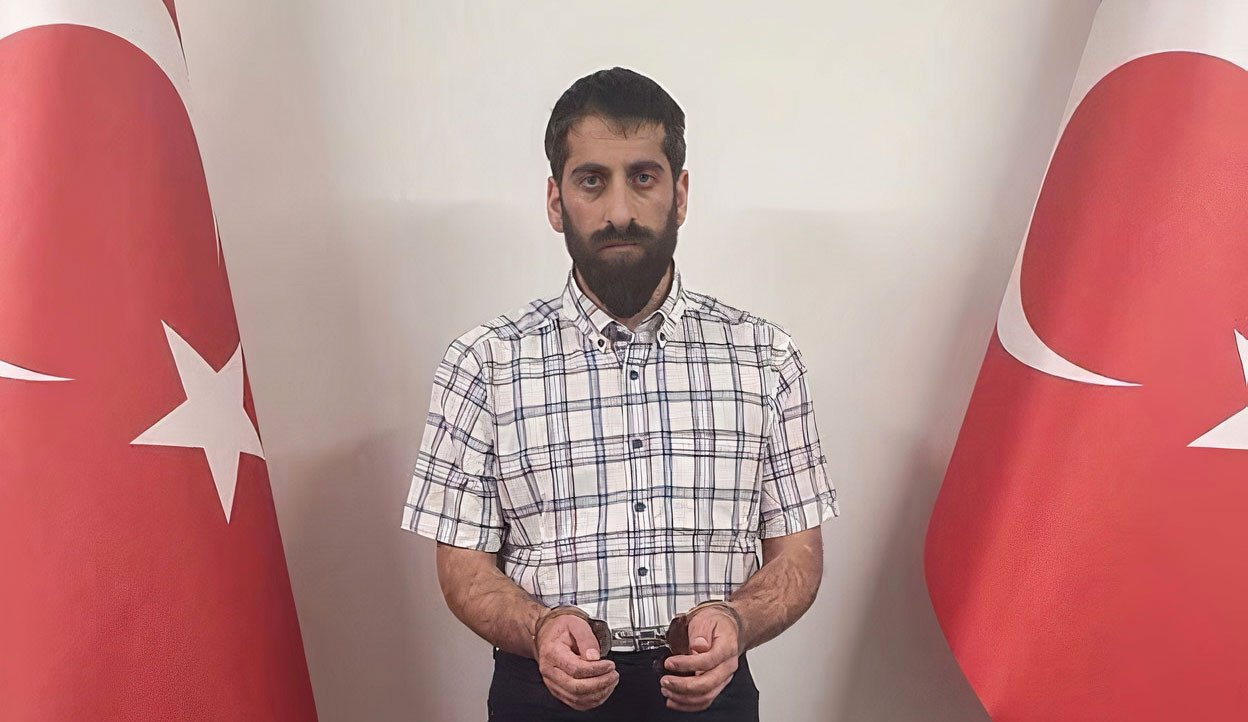Senior PKK terrorist Cimsit Demir in handcuffs after being caught in a Turkish intelligence operation in this undated photo released July 29, 2021. (AA Photo)