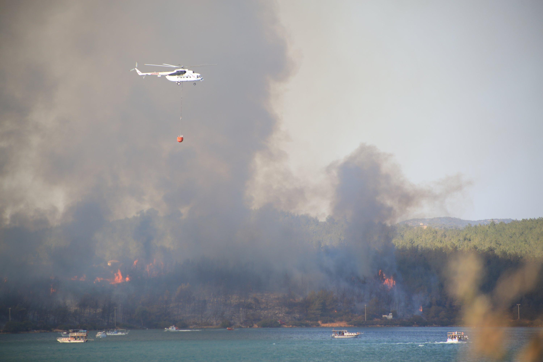 A forest fire burns in Milas district of Muğla province, southwestern Turkey, July 29, 2021. (AA Photo)