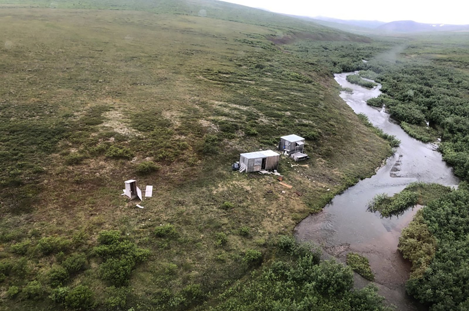 This photo provided by the U.S. Coast Guard District 17 shows a remote mining camp where a Coast Guard Air Station Kodiak aircrew rescued a survivor of a bear attack near Nome, Alaska, U.S., on July 16, 2021. (AP Photo)