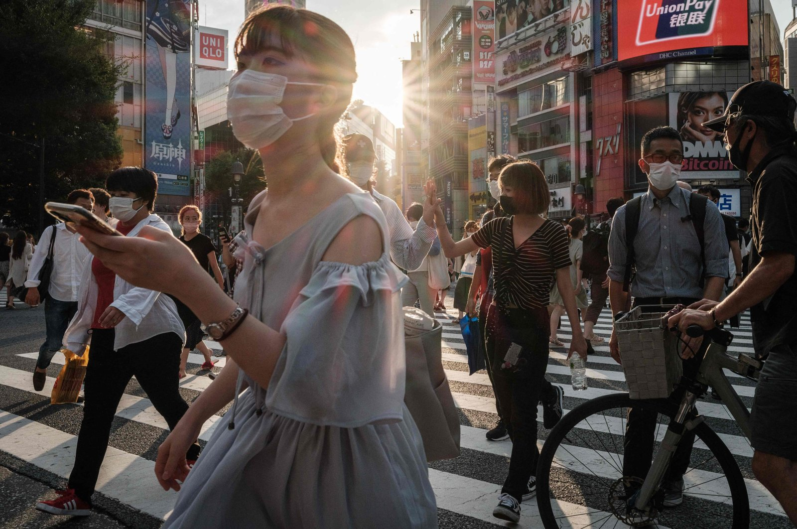 People wear face masks in Tokyo a day after the city reported a record 2,848 new daily COVID-19 cases, Tokyo, Japan, July 28, 2021. (AFP Photo)