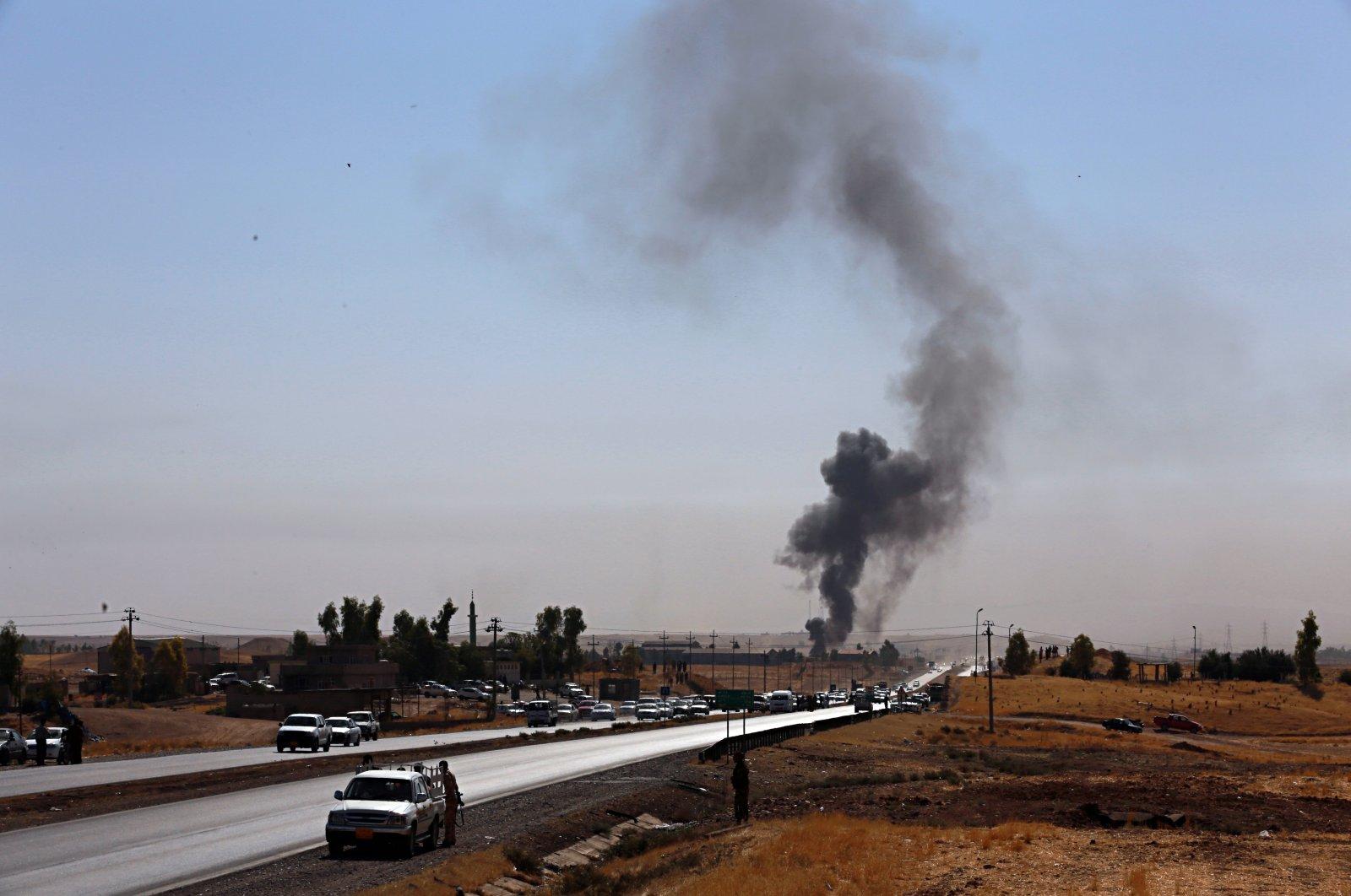 Smoke rises while in Alton Kupri, outskirts of Irbil, Iraq, Oct. 20, 2017. (AP Photo)