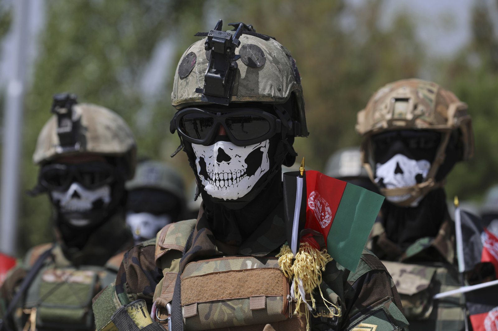 Masked Afghan Army Special Forces attend their graduation ceremony after a three-month training program at the Kabul Military Training Center, in Kabul, Afghanistan. July 17, 2021. (AP Photo)