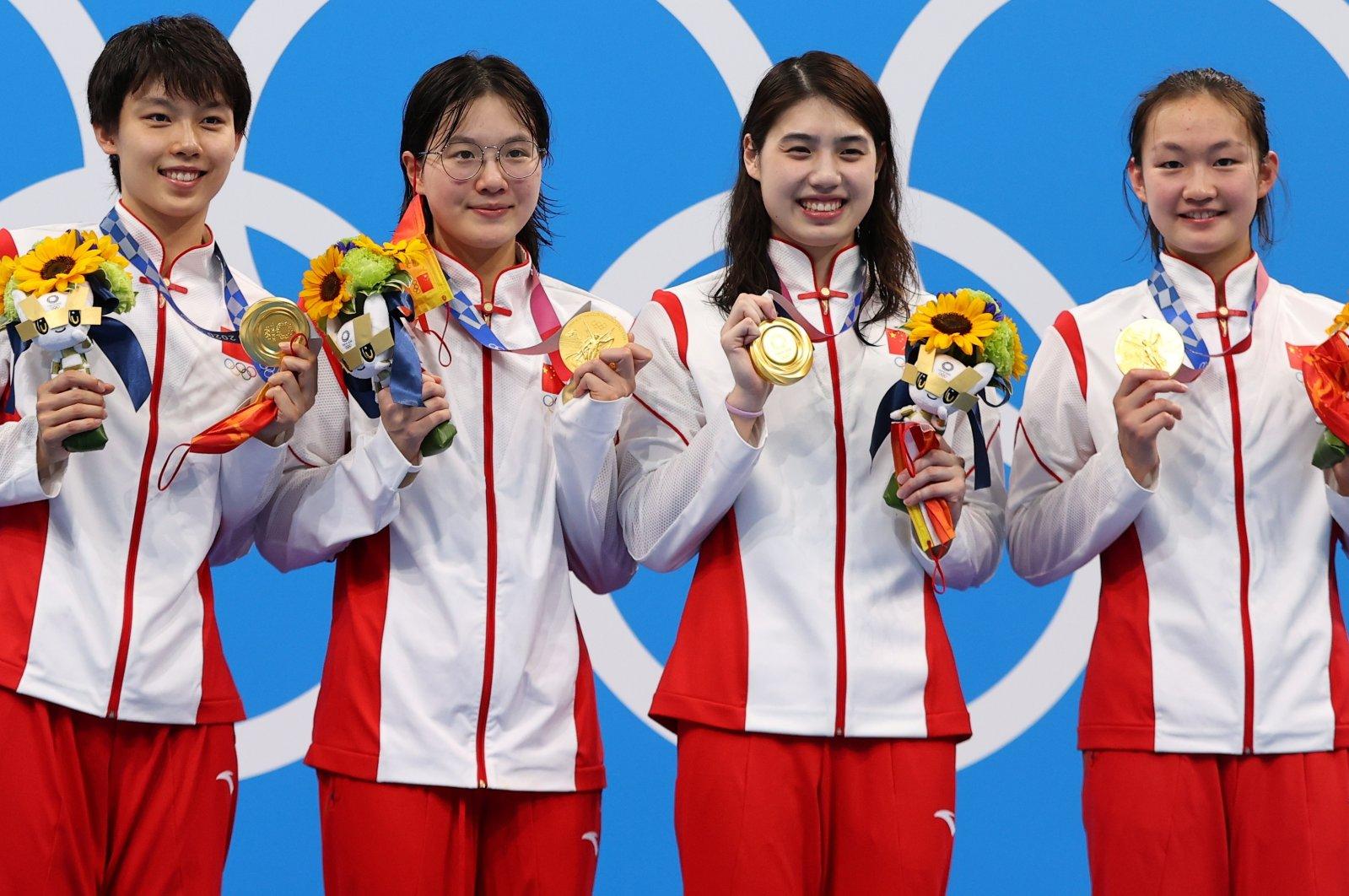 (From L to R) Women's 4 x 200-meter Freestyle Relay gold medallists China's Yang Junxuan, Tang Muhan, Zhang Yufei and Li Bingjie celebrate on the podium, Tokyo Aquatics Centre, Tokyo, Japan - July 29, 2021.