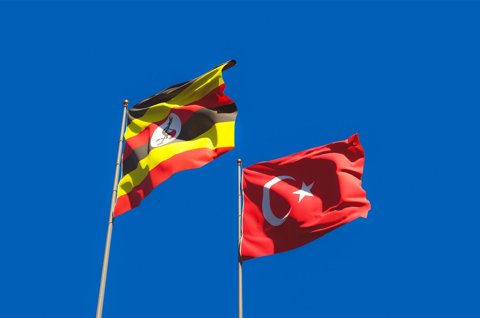 The Ugandan and Turkish flags fly at an unspecified location in this undated file photo. (Shutterstock File Photo)