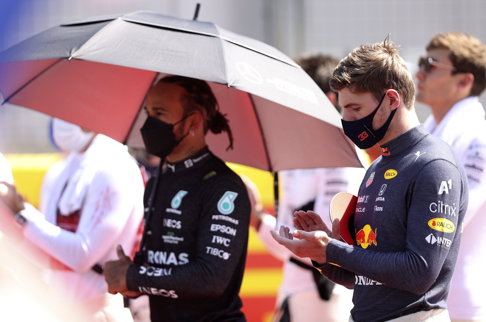 Red Bull driver Max Verstappen of the Netherlands and Mercedes driver Lewis Hamilton of Britain (L) stand on the grid before the start of the British Formula One Grand Prix, at the Silverstone circuit, in Silverstone, England, July 18, 2021. (AP Photo)