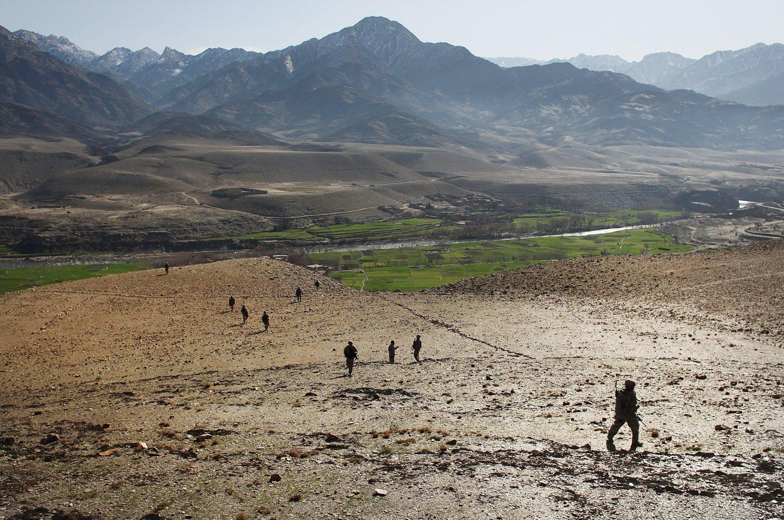 U.S. soldiers patrol areas near the village of Baba Kala, Nuristan province, eastern Afghanistan, Feb. 17, 2009. (Getty Images)