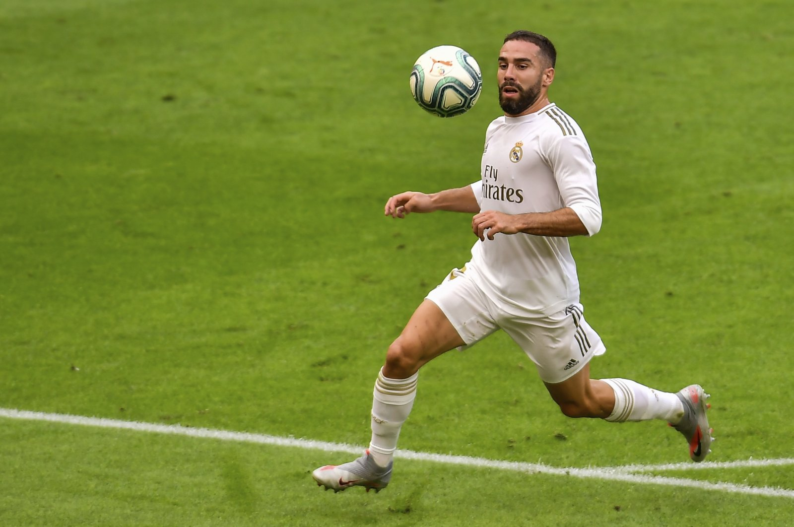 Real Madrid's Dani Carvajal views the ball during the Spanish La Liga match against Athletic Club at the San Manes stadium in Bilbao, Spain, July 5, 2020. (AP Photo)