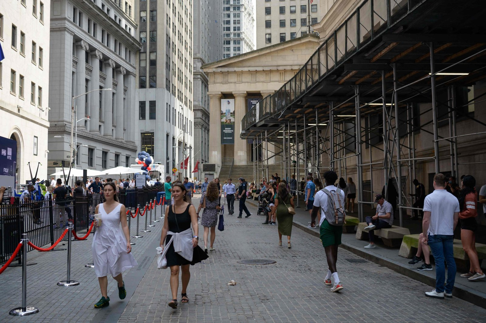 People walk past the New York Stock Exchange (NYSE) on Wall Street in New York City, U.S., July 15, 2021. (AFP Photo)