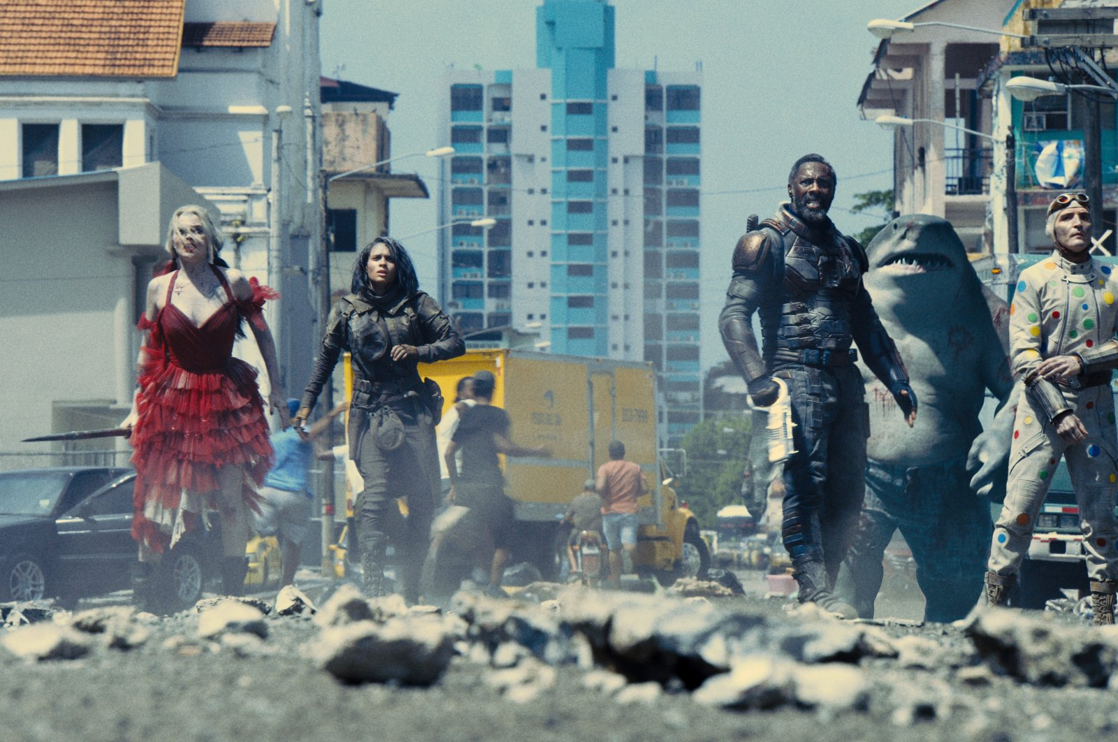 """This image provided by Warner Bros. Pictures shows, from left, Margot Robbie, Daniela Melchior, Idris Elba and David Dastmalchian in a scene from """"The Suicide Squad."""" (Warner Bros. Pictures via AP)"""