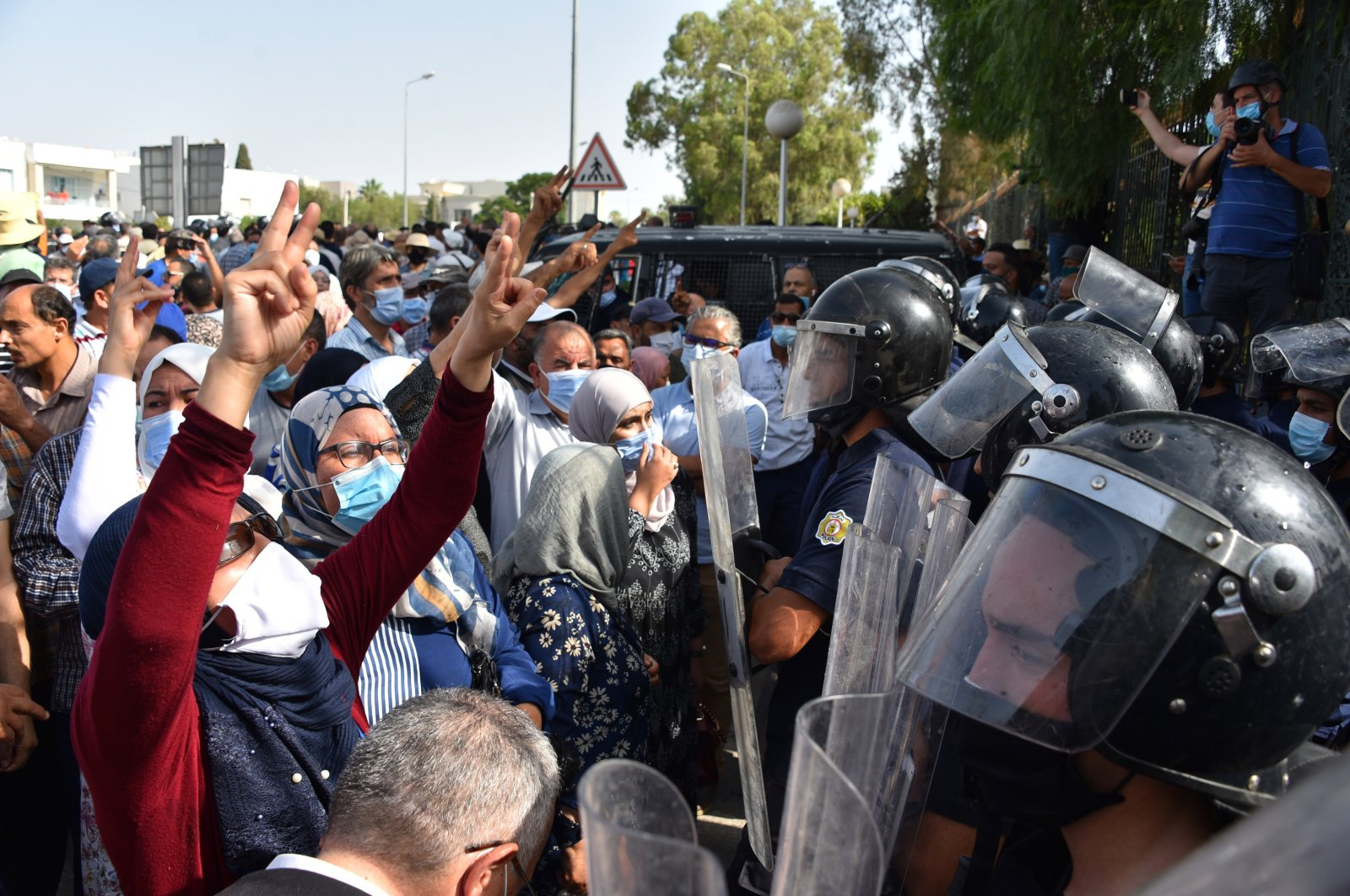 Supporters and opponents of coup chant slogans in front of parliament building during the demonstration, in capital Tunis, Tunisia, on July 26, 2021. (Getty Images Photo)