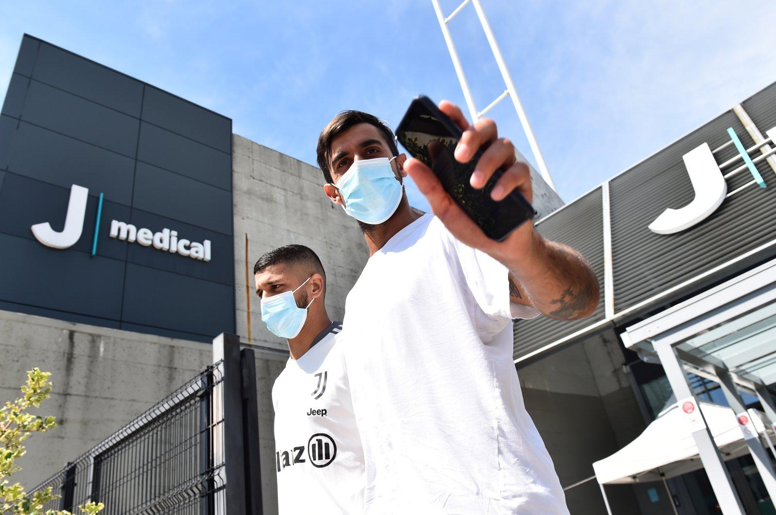 Juventus' Mattia Perin and Hamza Rafia (L) arrives for training at Juventus Training Center, Turin, Italy, July 14, 2021. (Reuters Photo)