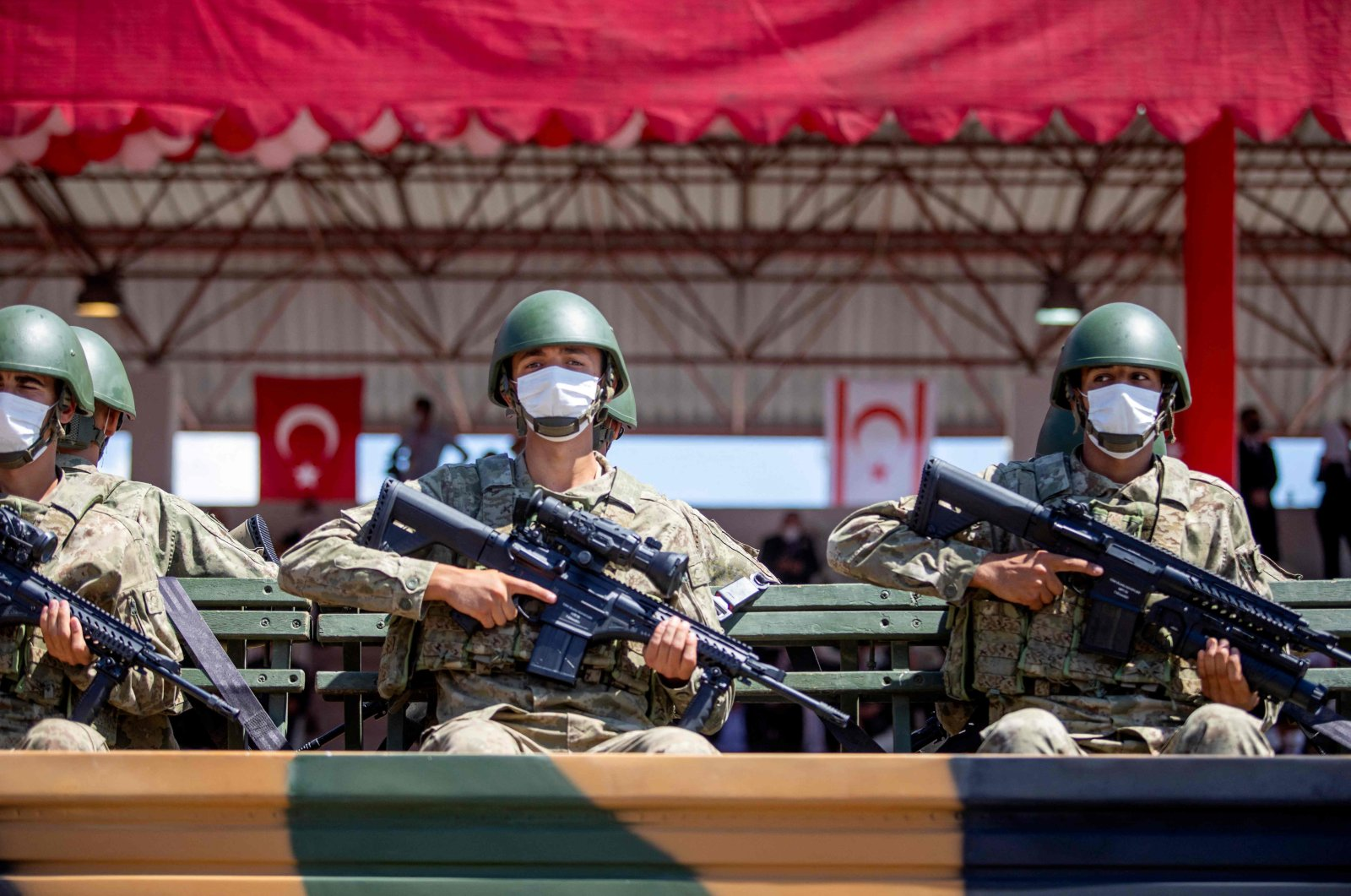 Soldiers take part in a military parade in the Turkish Republic of Northern Cyprus on July 20, 2021. (AFP Photo)