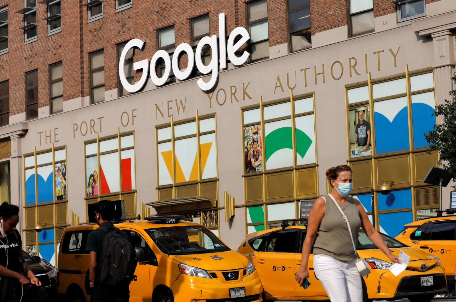 A person in a mask walks by the New York Google office in Manhattan, New York City, U.S., July 29, 2021. (Reuters Photo)