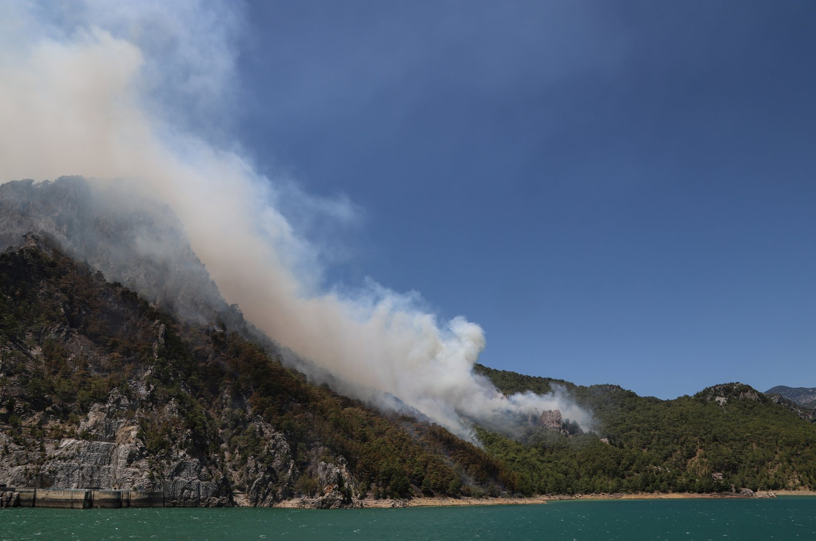 A forest fire burns near the town of Manavgat, east of the resort city of Antalya, Turkey, July 29, 2021 (Reuters Photo)