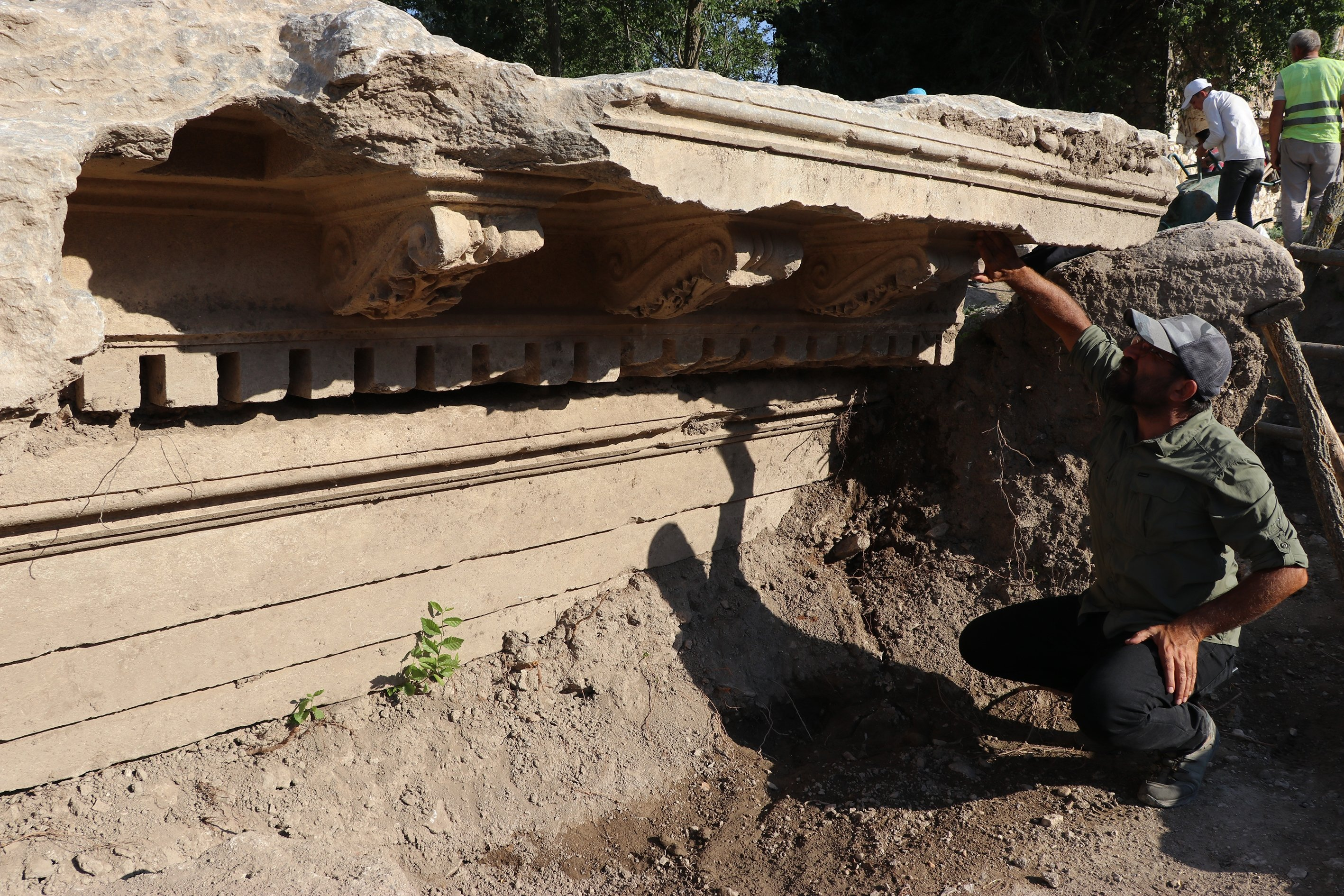 Archaeologists work on the monumental entrance gate of the Zeus Temple