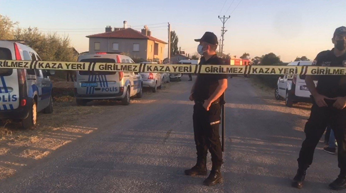 Officers stand behind a police cordon near the house of deceased family members in Turkey's central Konya province, Friday, July 30, 2021. (IHA Photo)