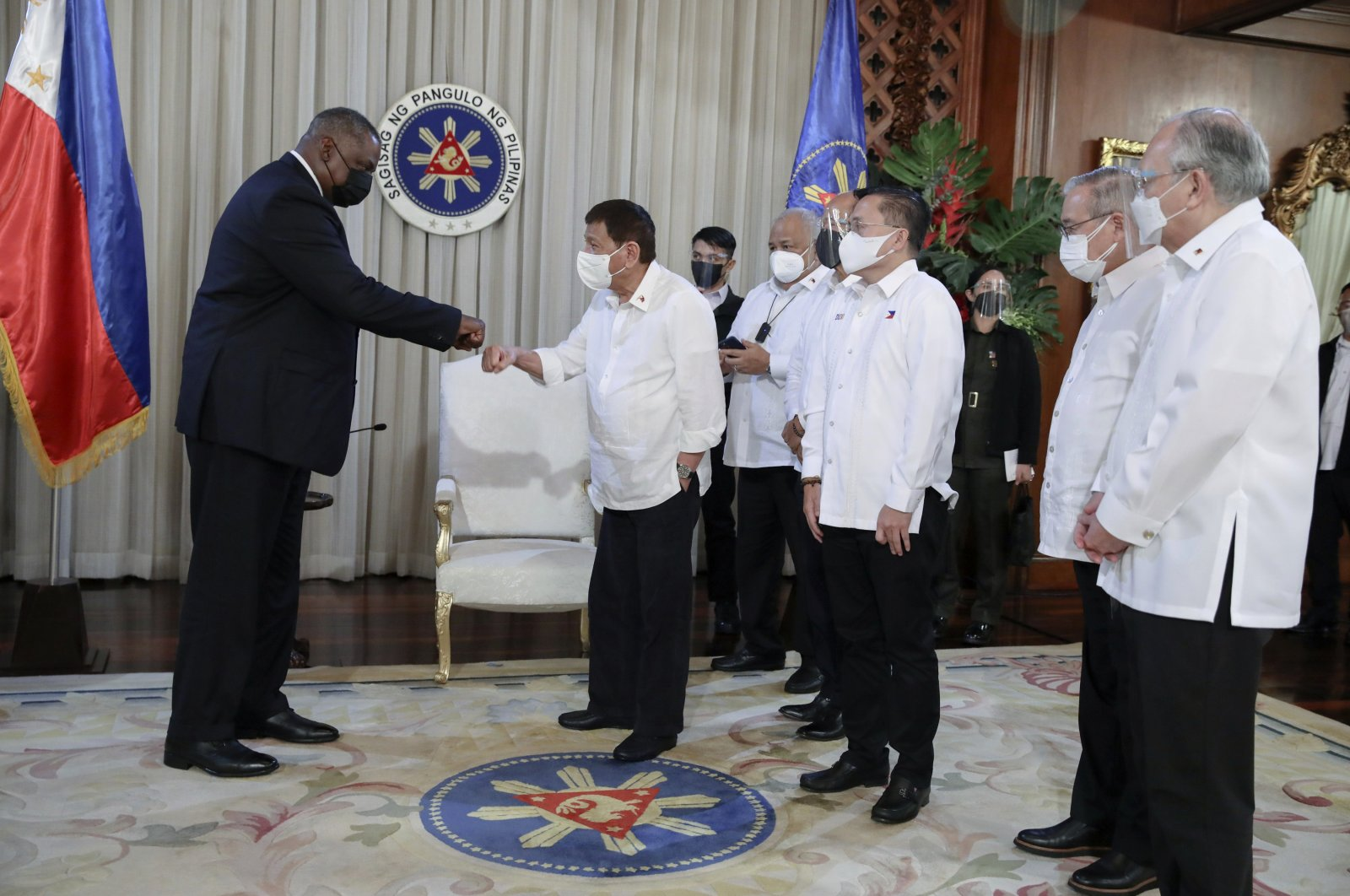 In this photo provided by the Malacanang Presidential Photographers Division, U.S. Secretary of Defense Lloyd Austin (L) does a fist bump with Philippine President Rodrigo Duterte during a courtesy call on the president at the Malacanang Palace in Manila, Philippines, July 29, 2021. (AP Photo)