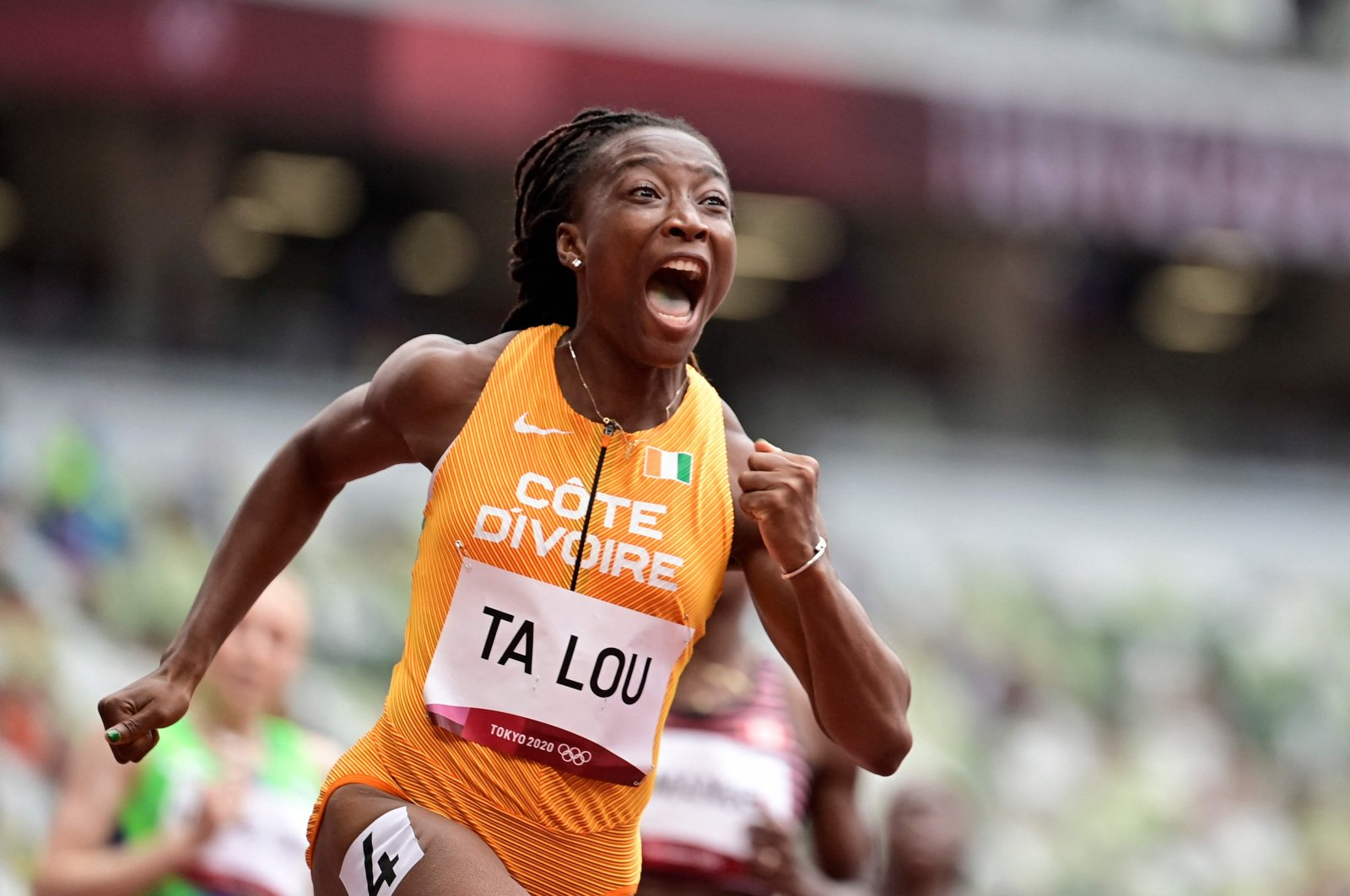 Marie-Josee Ta Lou, of the Ivory Coast, wins a heat in the women's 100-meter run at the 2020 Summer Olympics, in Tokyo, Japan, July 30, 2021. (AFP Photo)