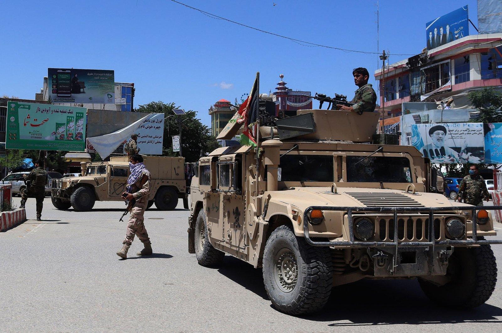 Afghan security forces sit in a Humvee vehicle amid ongoing fighting between Taliban militants and Afghan security forces in Kunduz, Afghanistan, on May 19, 2020. (AFP Photo)