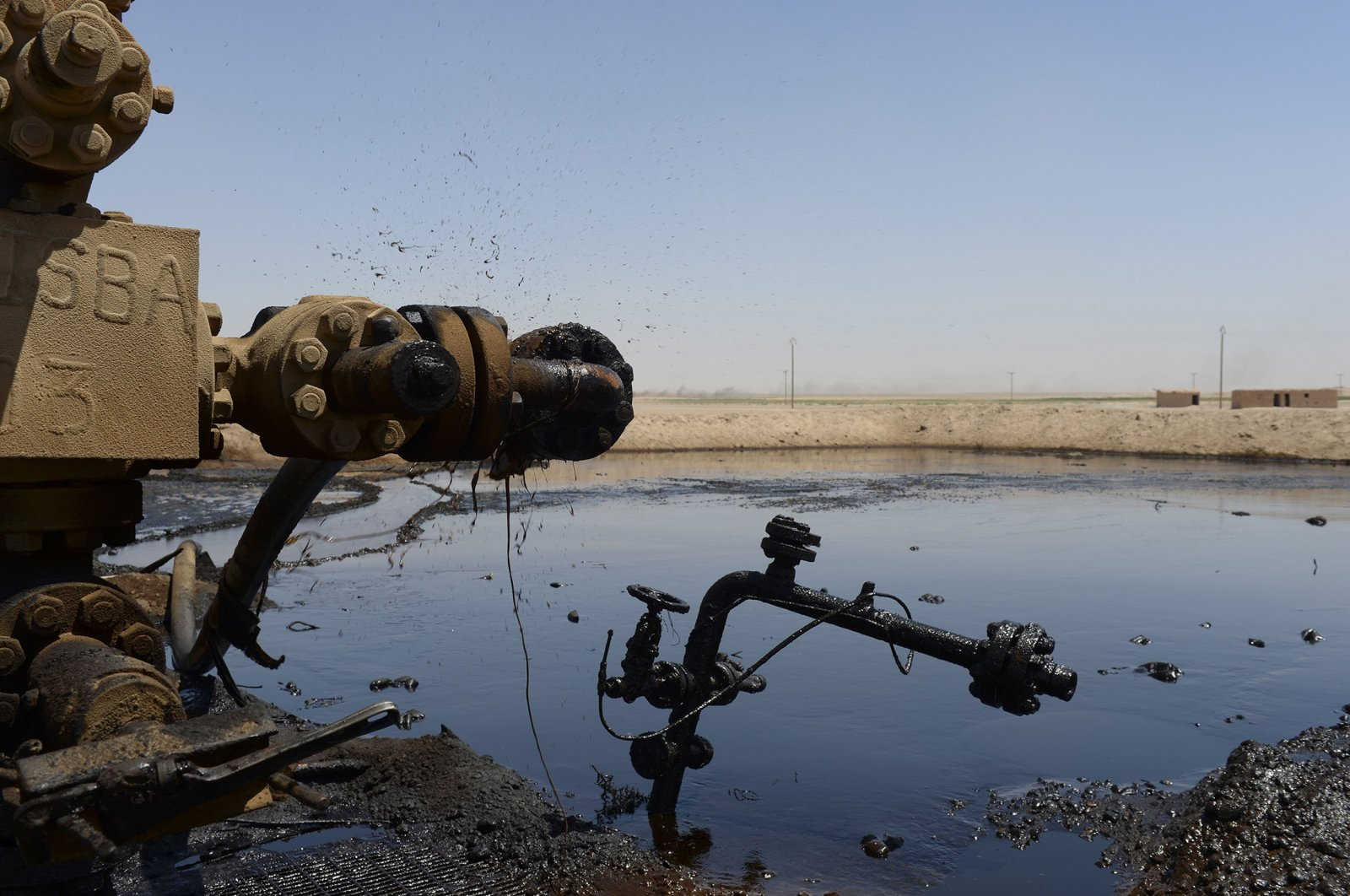 """Oil fields in Deir el-Zour, eastern Syria are seen in this undated photo Syria with primitive """"refineries,"""" which produce ugly wasteland all along the main road through the area. (Getty Images)"""