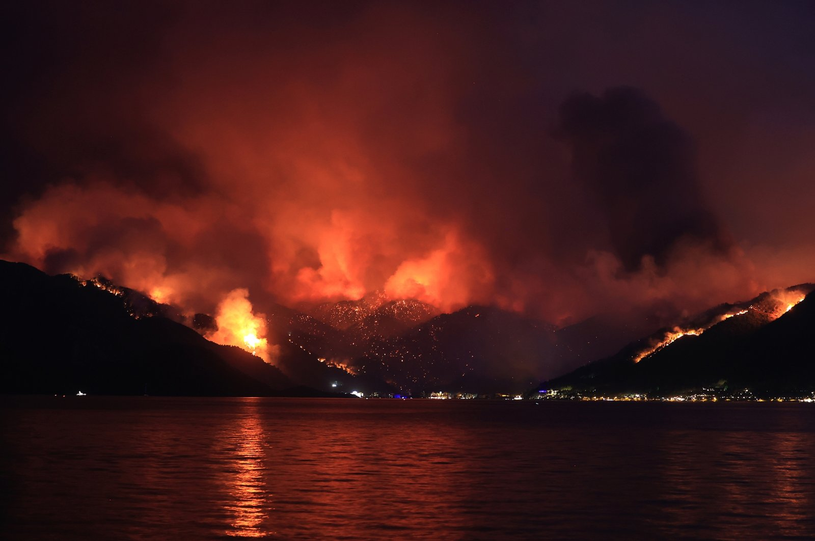 Flames and smoke tower over the town of Marmaris, in Muğla, southwestern Turkey, July 29, 2021. (AA PHOTO)