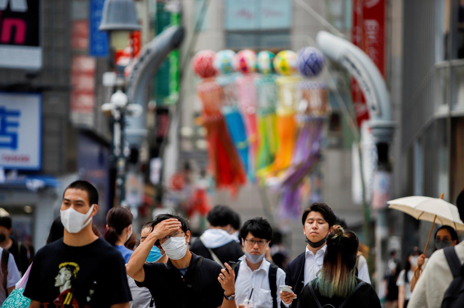 People walk at the Shibuya crossing in Tokyo, Japan, July 29, 2021. (Reuters Photo)