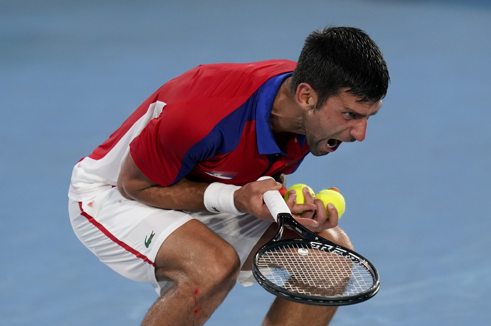 Novak Djokovic, of Serbia, reacts during a semifinal men's tennis match against Alexander Zverev, of Germany, at the 2020 Summer Olympics, Tokyo, Japan, Friday, July 30, 2021. (AP Photo)