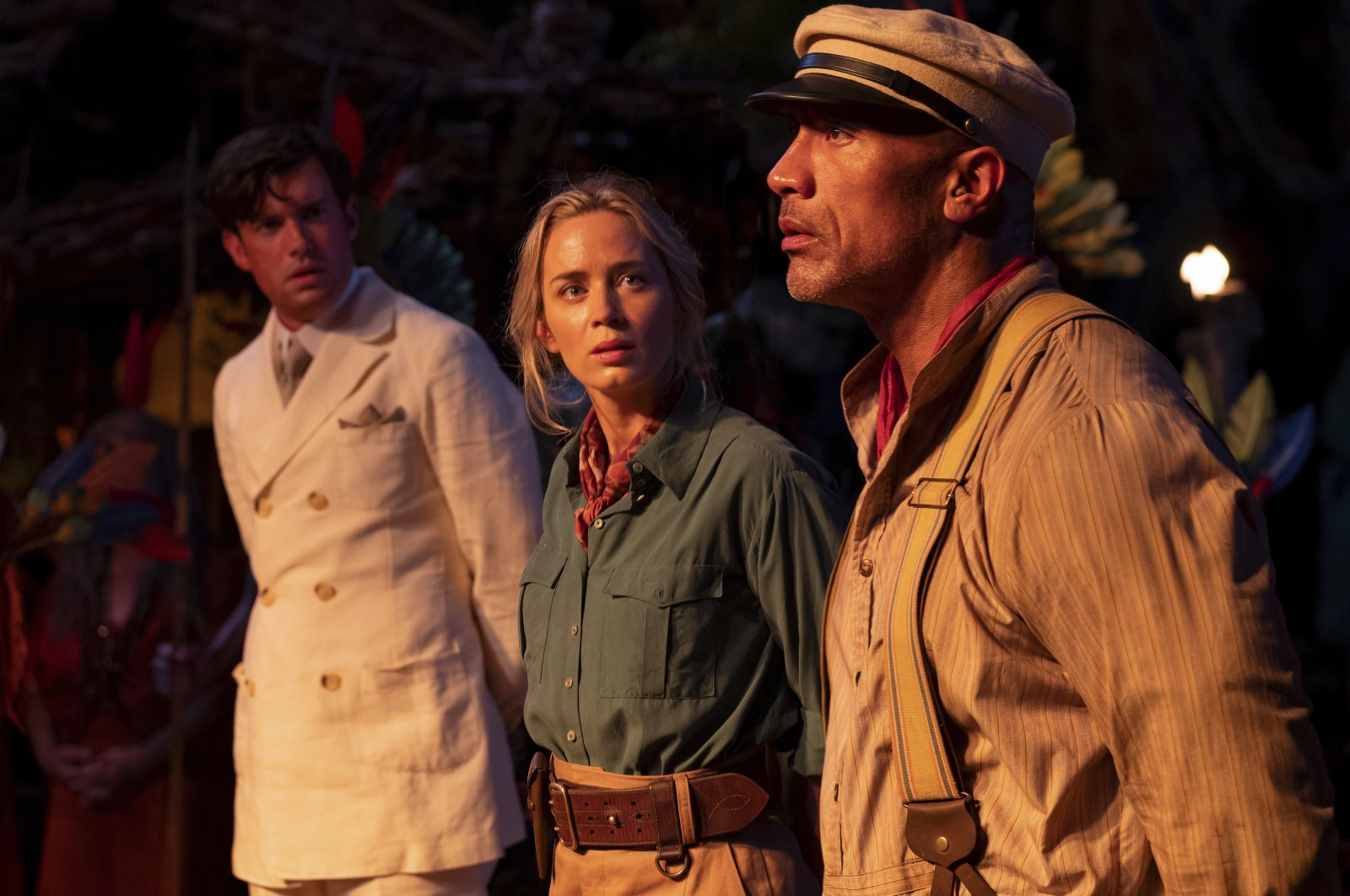 """This image released by Disney shows, from left, Jack Whitehall, Emily Blunt and Dwayne Johnson in a scene from """"Jungle Cruise."""" (Disney via AP)"""