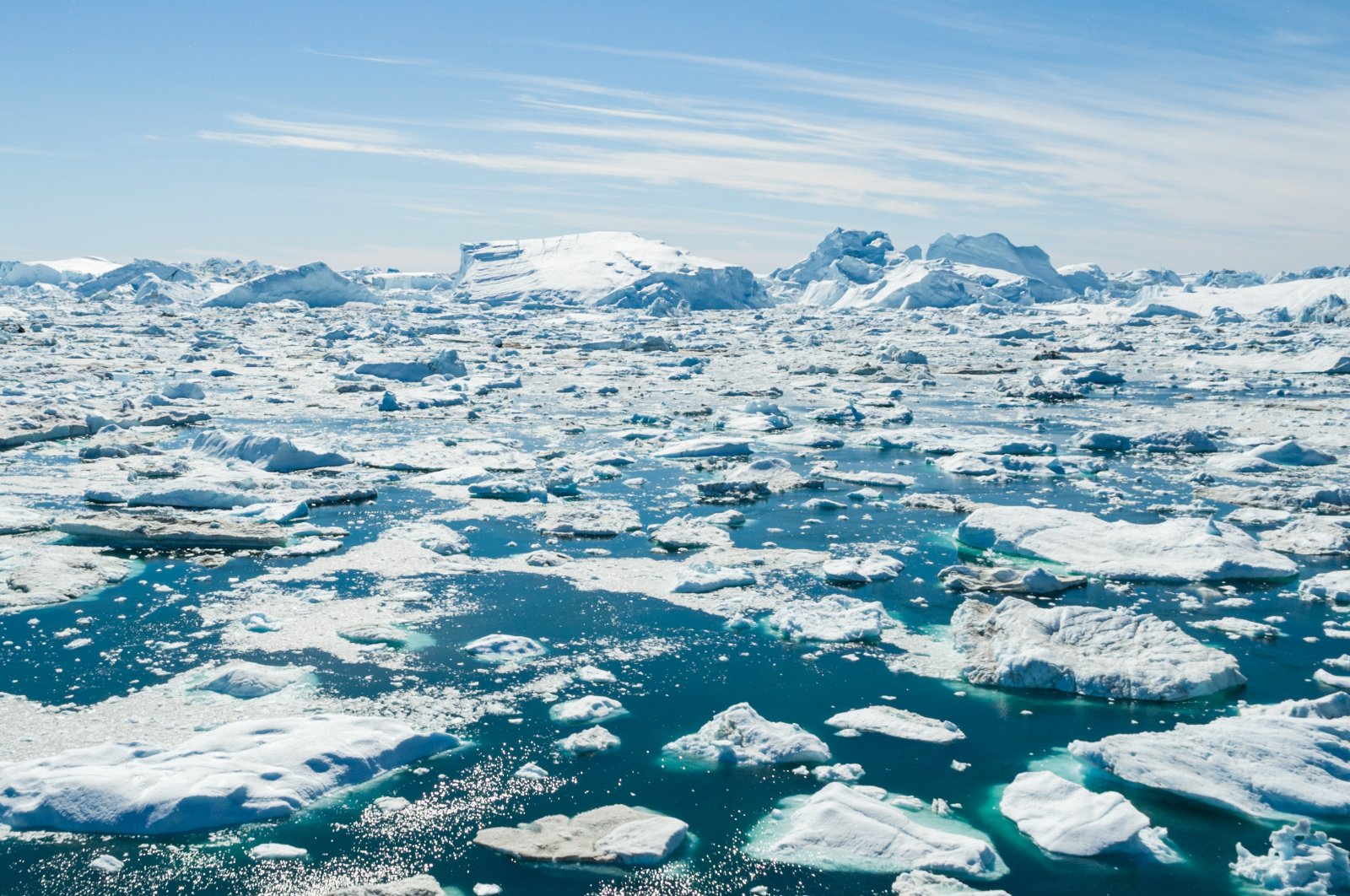 Icebergs and ice in the Arctic off Greenland. (Shutterstock Photo)