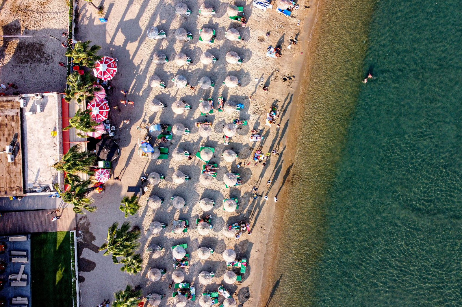 People are seen on a beach in the city of Bodrum, a tourist hotspot on the Aegean Sea, southwestern Turkey, July 23, 2021. (Reuters Photo)