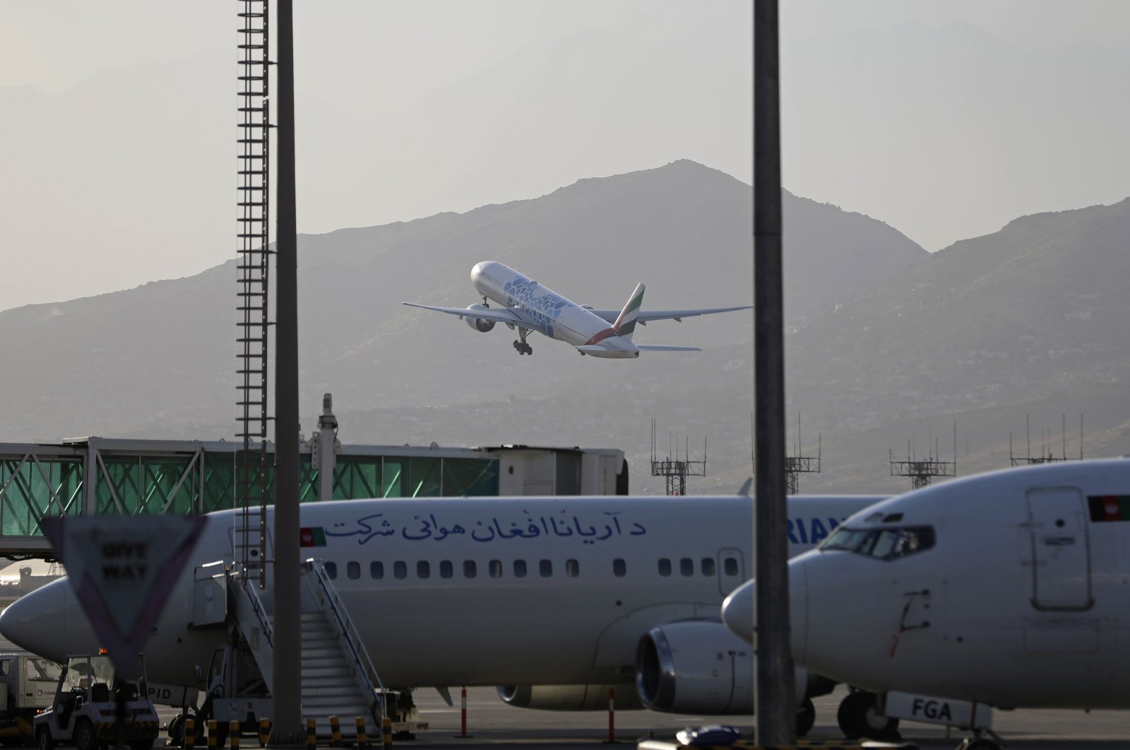 A plane takes off from Hamid Karzai International Airport in Kabul, Afghanistan, Sunday, July 4, 2021. (AP Photo)