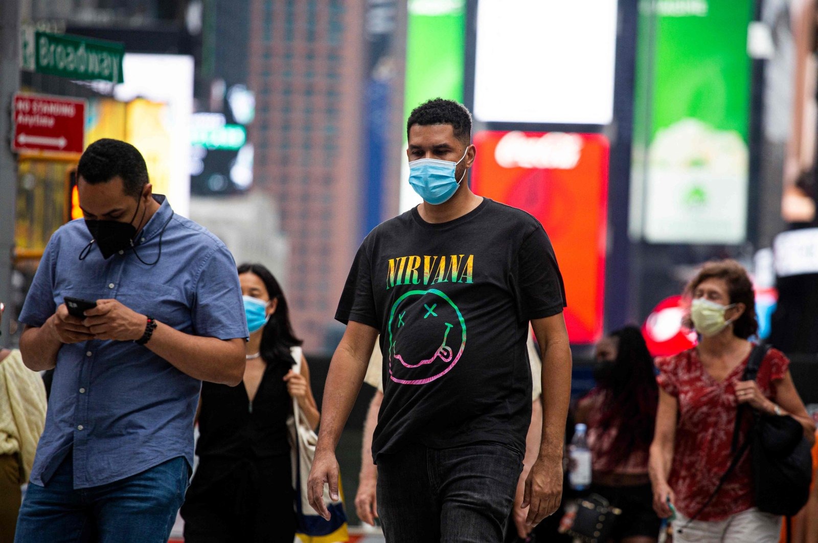 People walk by wearing face masks to combat COVID-19, in Midtown Manhattan, New York, U.S., July 29, 2021. (AFP Photo)